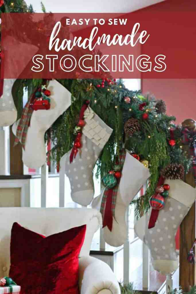 How to make beautiful handmade Personalized Christmas stockings. |DIY Personalized Christmas Stockings by popular Canada DIY blog, Fynes Designs: Pinterest image of grey and white stockings hanging on a stair banister decorated with garland and christmas ornaments.
