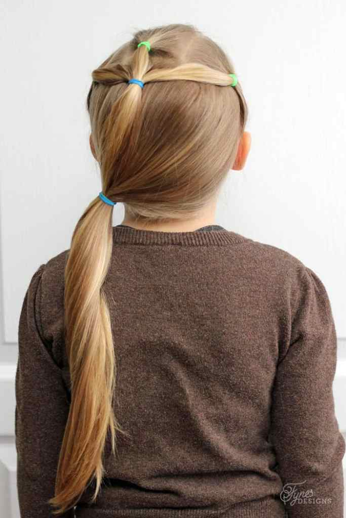 Simple and cute Hairdos for Girls- perfect 5 minute dos for school days |5 Minute Hairstyles by popular Canada lifestyle blog, Fynes Designs: image of a side ponytail hairstyle.