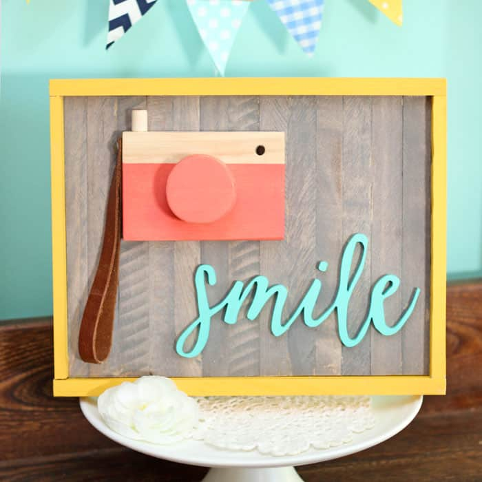 Smile wood camera painted sign