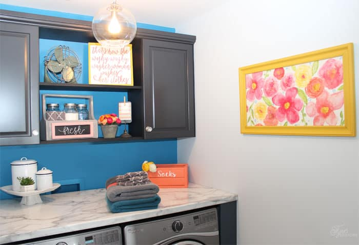 Fresh laundry room makeover featuring 2015 color of the year Blue Paisley
