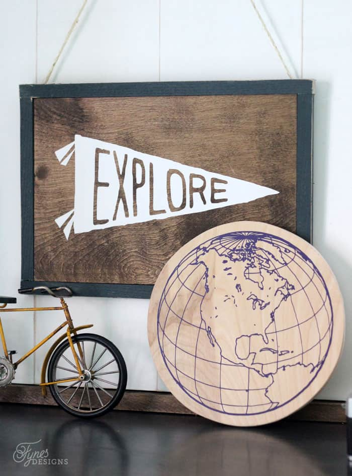 How to Use Heat Transfer Vinyl on Wood, a tutorial featured by top US home decor blog, Fynes Designs | Did you know you can use HTV on wood?! Works awesome for fine lines- click to learn how to make this globe sign