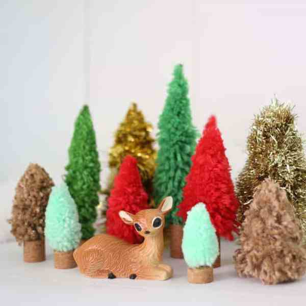 Easy DIY Christmas trees. Buy the DIY Bottle Brush Tree Kit at JoAnn and Hazel and Ruby