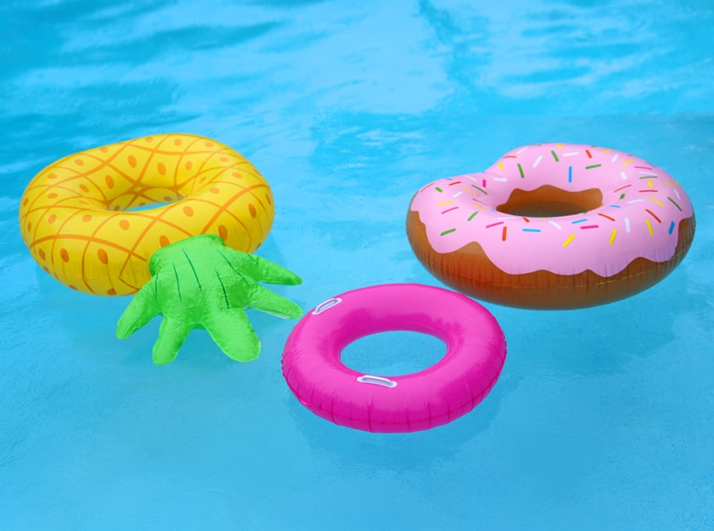 Summer pool floaties. Pineapple and donut floaties