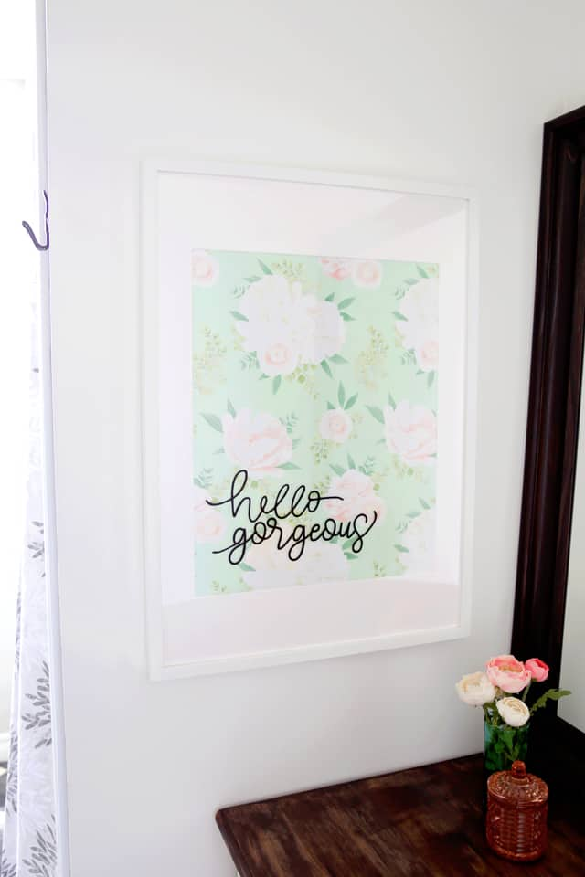 what a great idea! Frame a piece of pretty wrapping paper for cheap artwork
