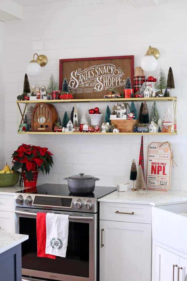 Christmas kitchen vintage vignette with hand painted wood signs |DIY Wooden Sled by popular Canada DIY blog, Fynes Designs: image of a kitchen decorated in vintage Christmas decor.