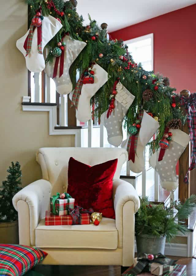 Stockings hung on the banister with natural garland