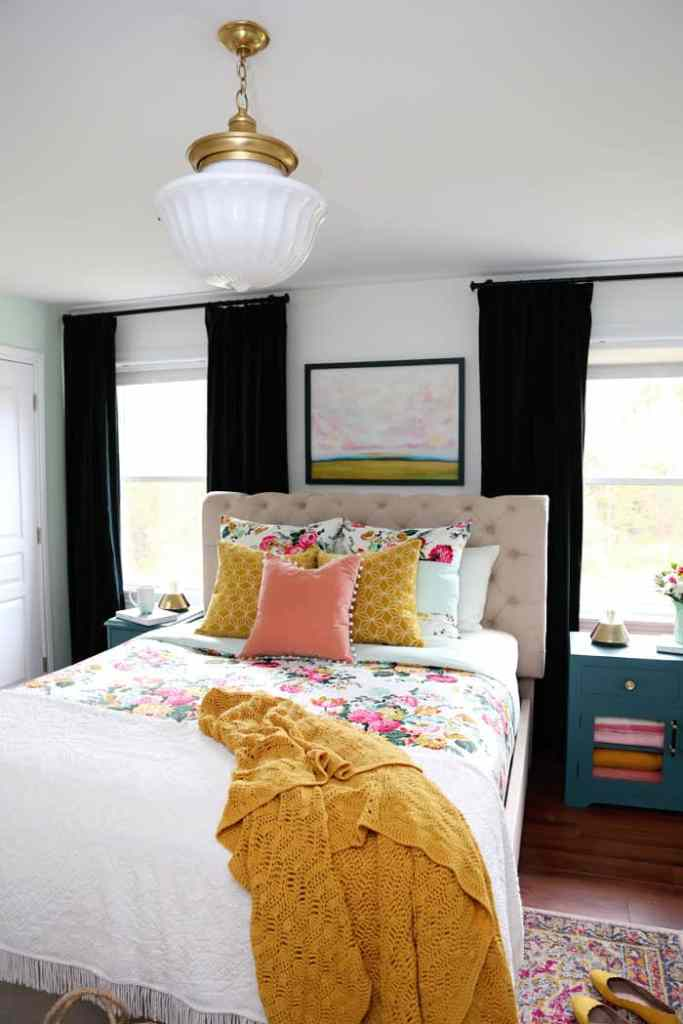 Hudson Valley Light in a colourful master bedroom | Bright and Colourful Master Bedroom refresh | Colorful Master Bedroom Refresh by popular home decor blog, FYN Designs: image of a bright and colorful master bedroom with a Hudson Valley Duchess pendant light, floral bedding, and D. Lawless hardware Champagne Bronze Francisco Pulls.