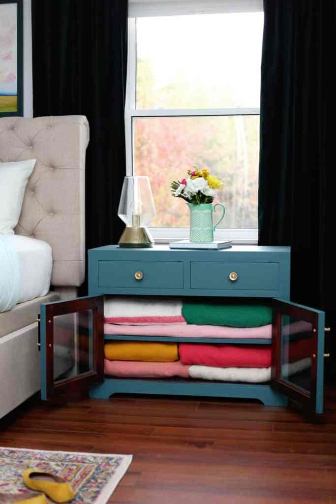 TV stand repurposed as a blanket chest | Bright and Colourful Master Bedroom refresh | Colorful Master Bedroom Refresh by popular home decor blog, FYN Designs: image of a bright and colorful master bedroom with a tv stand repurposed as a blanket cabinet.