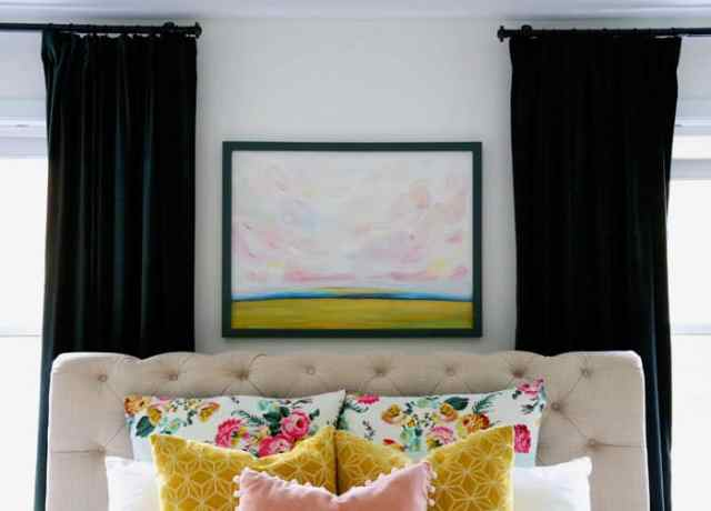 Hand painted colorful clouds | Bright and Colourful Master Bedroom refresh | Colorful Master Bedroom Refresh by popular home decor blog, FYN Designs: image of a bright and colorful master bedroom with a Hudson Valley Duchess pendant light, floral bedding, and D. Lawless hardware Champagne Bronze Francisco Pulls.