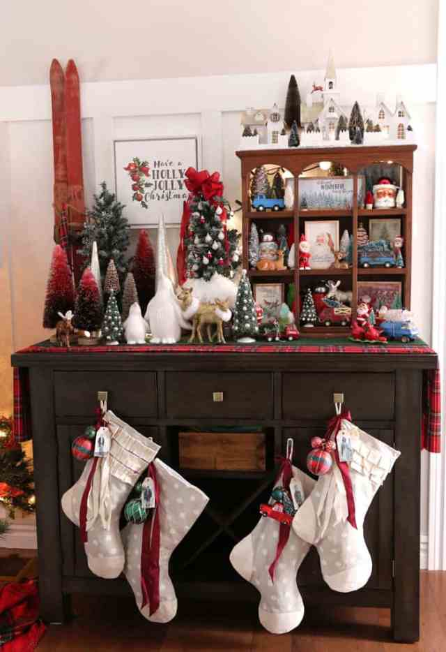 Easy to sew Christmas Stockings featured by top design blog, Fynes Designs: Red themed Christmas decorations |DIY Personalized Christmas Stockings by popular Canada DIY blog, Fynes Designs: image of grey and white stockings handing on a dresser decorated with bottle brush trees and vintage Christmas decor.