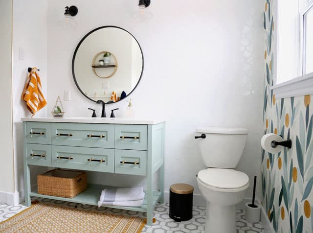 Colourful Bathroom Makeover Ideas: Before and After Pictures featured by top US design blog, Fynes Designs: Modern bathroom with light green vanity