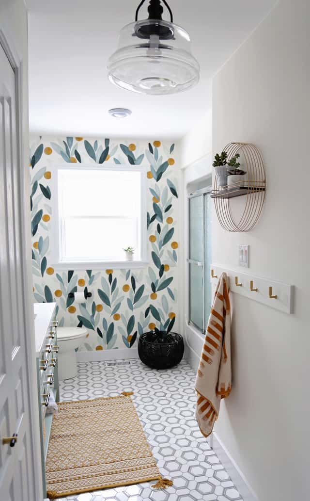Colourful Bathroom Makeover Ideas: Before and After Pictures featured by top US design blog, Fynes Designs: hand painted accent wall in a modern bathroom