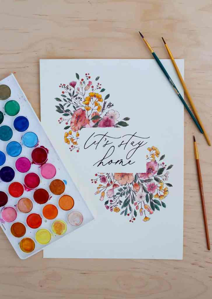 How to Print on Watercolor paper at home. 4 free wildflower art prints to try! | How to Print on Watercolor Paper by popular US interior design blog, Fynes Designs: image of watercolor paint pallet and wildflower Let's Stay Home printable.