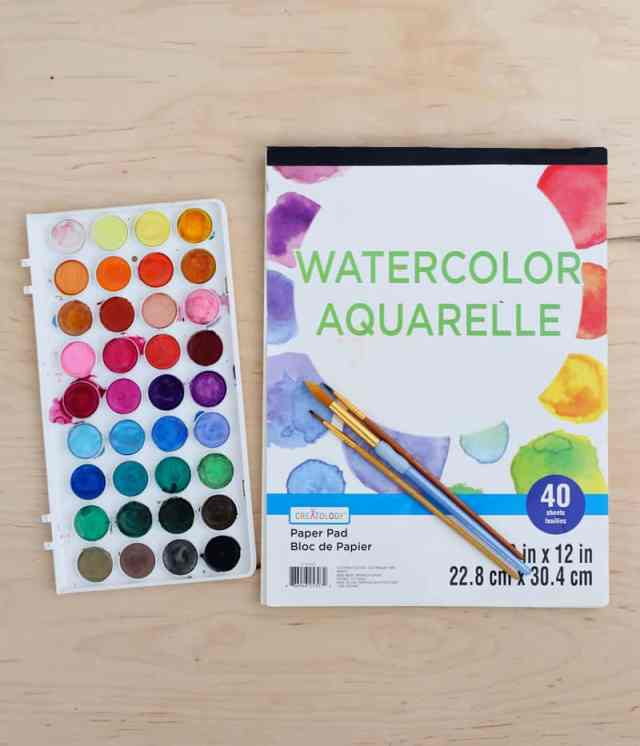 How to Print on Watercolor paper at home. Plus wildflower art prints free | How to Print on Watercolor Paper by popular US interior design blog, Fynes Designs: image of watercolor paper and watercolor paint pallet.