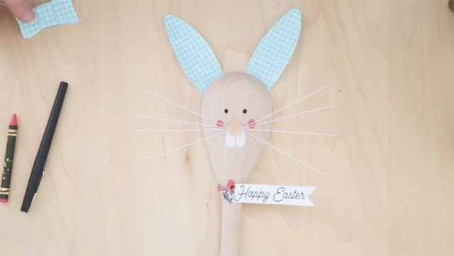 Easter Bunny Crafts: How to Make a Cute Wooden Spoon Easter Bunny, a tutorial featured by top craft blog, Fynes Designs: glue the Happy Easter banner in place | Easter Bunny Crafts by popular interior design blog, Fynes Designs: image of wooden spoon Easter Bunny.