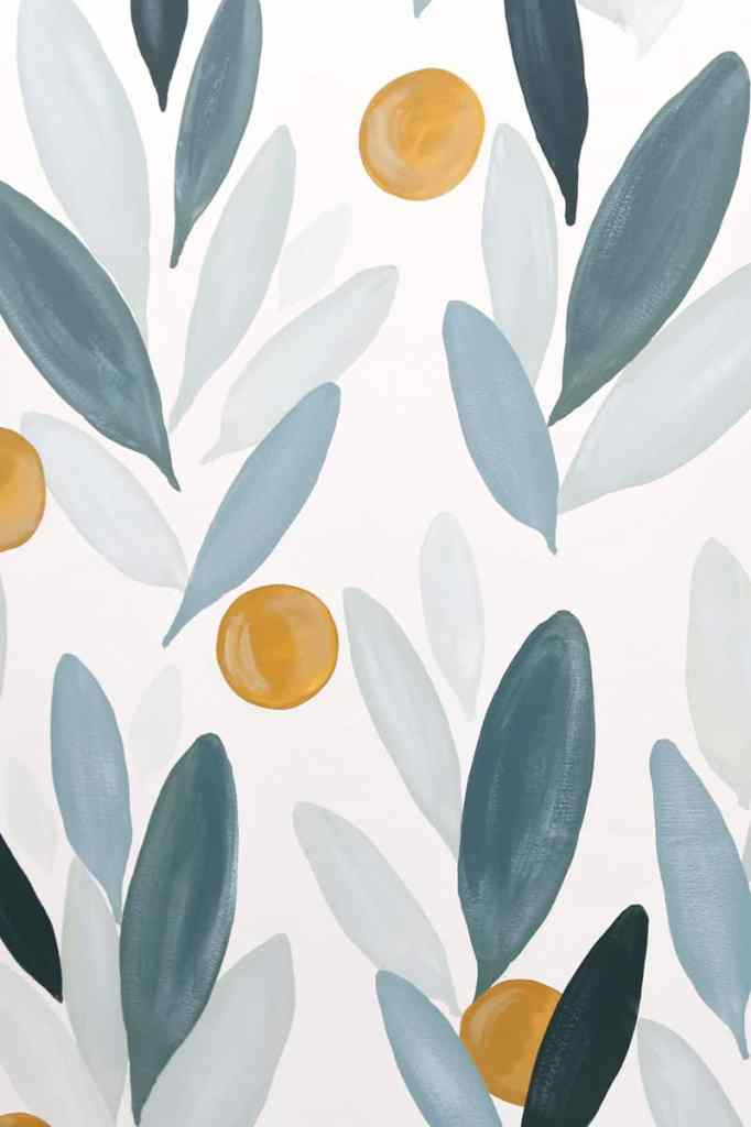 How to paint your own wallpaper mural, a step by step tutorial featured by top life and style blog, Fynes Designs | How to Paint Over Wallpaper in a Bathroom by popular US DIY blog, Fynes Designs: image of a wall painted with green leaves.