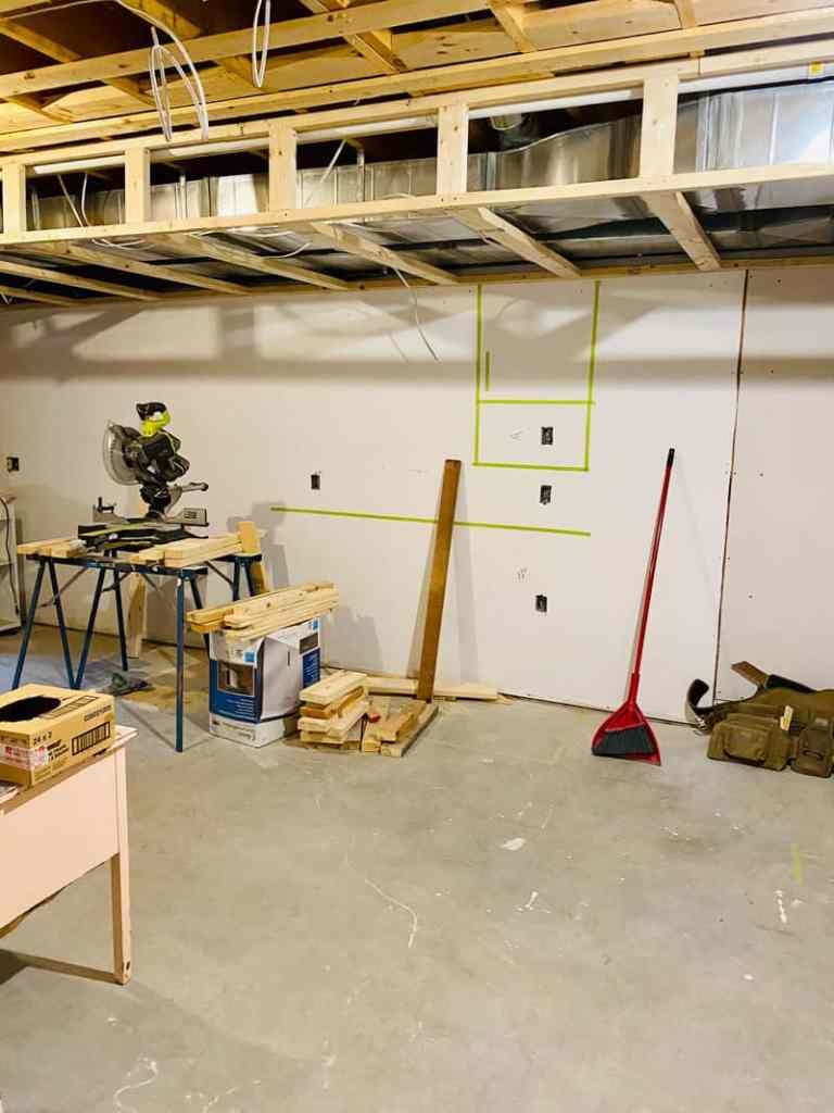 basement framing Jeffrey Court renovation challenge | Jeffrey Court by popular US life and style blog, Fynes Designs: image of a framed basement.