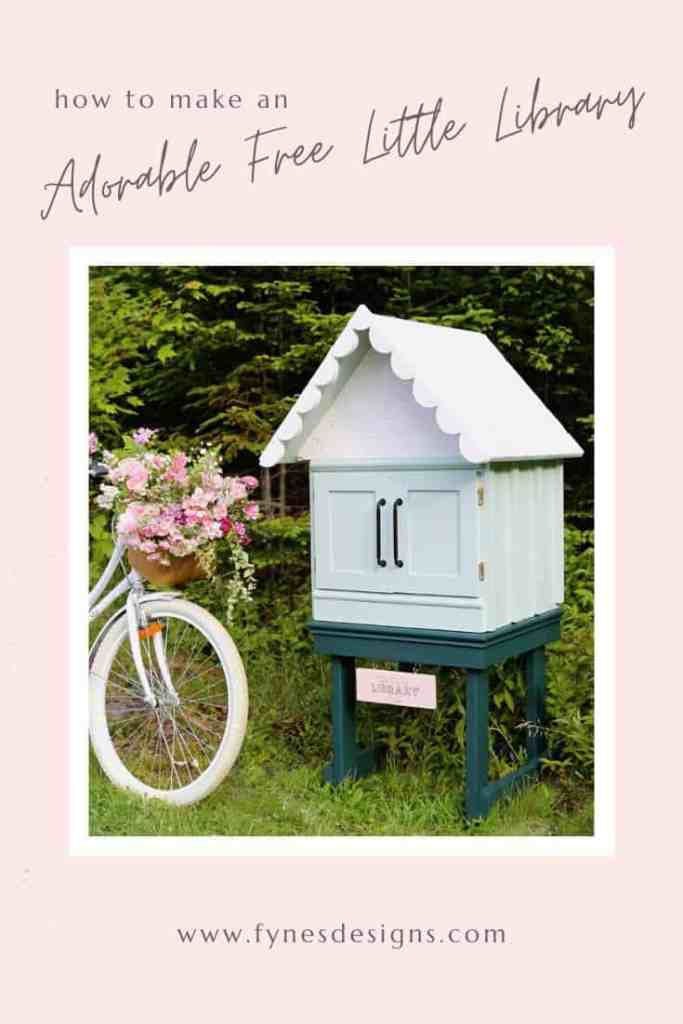 Little Free Library Plans by popular US DIY blog, Fynes Designs: Pinterest image of a free little library next to a white beach cruiser bike with a wicker basket full of pink flowers.