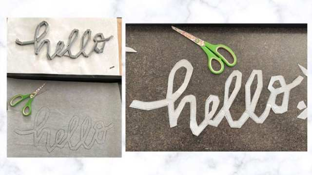 Tile Lettering by popular US interior design blog, Fynes Designs: image of the word 'hello' in cut out parchement paper next to some scissors with green handles.