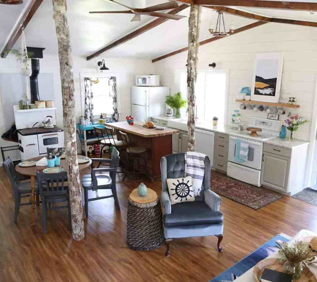 Outdated 1980's Cottage gets a drastic makeover |Farmhouse Cottage by popular Canada DIY blog, Fynes Designs: image of a farmhouse cottage living room and kitchen.