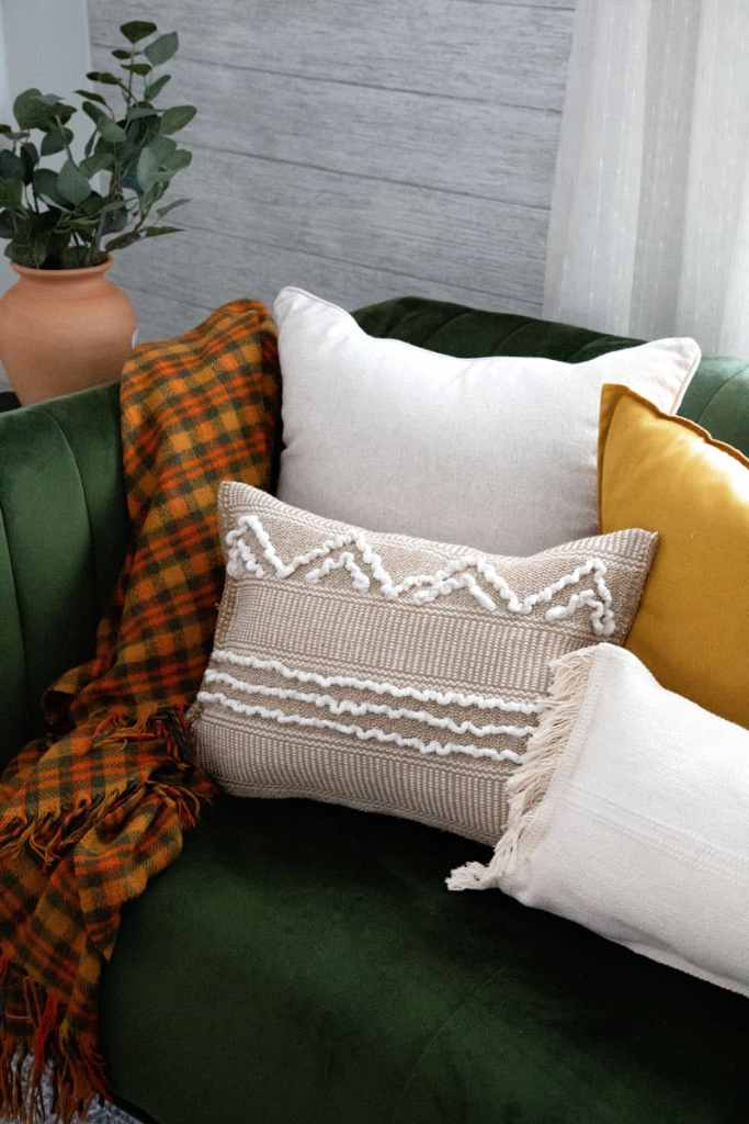 Try this IKEA Hack to turn these rugs into boho pillows |Fabric Pumpkins by popular Canada craft blog, Fynes Designs: image of no-sew IKEA hack pillows.