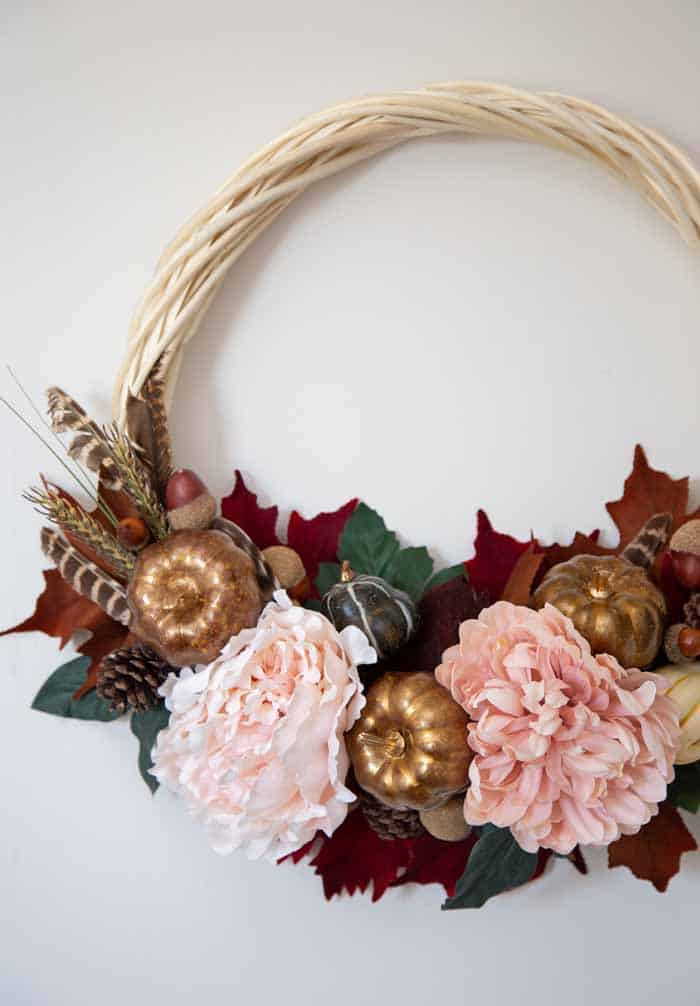 How to make a pretty fall wreath for the door |  Fall Wreath by popular Canada DIY blog, Fynes Designs: image of a fall wreath with faux flowers, faux leaves, Styrofoam pumpkins and Styrofoam acorns.