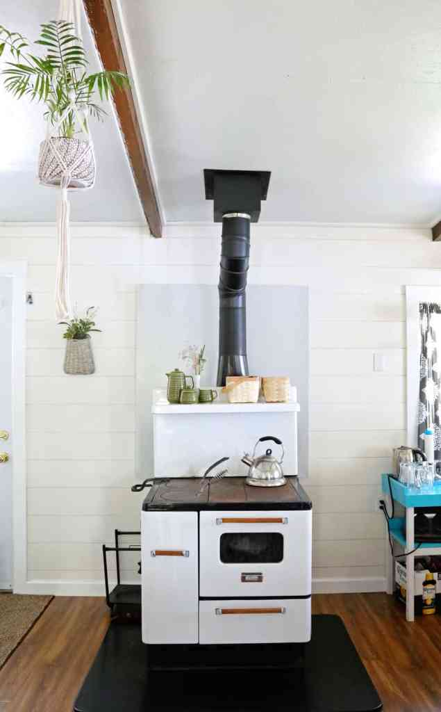 Vintage Farmhouse kitchen cook stove. Click to see how a dated 1980s lake house was transformed into a beautiful farmhouse inspired cottage. |Farmhouse Cottage by popular Canada DIY blog, Fynes Designs: after image of a retro wood burning stove.