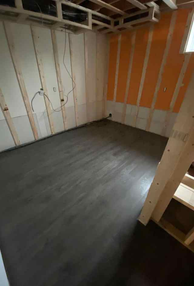 How to put Flooring in a basement |Vinyl Plank Flooring by popular Canada interior design blog, Fynes Designs: image of vinyl plank flooring in a basement.