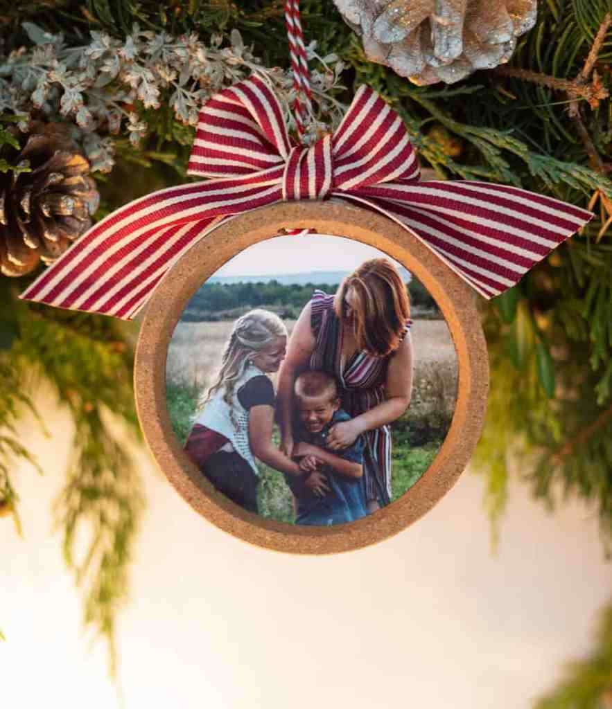Learn how to make an easy keepsake photo ornament from IKEA coasters |Photo Ornament by popular Canada DIY blog, Fynes Designs: image of a woman holding a photo ornament made from a IKEA coaster.