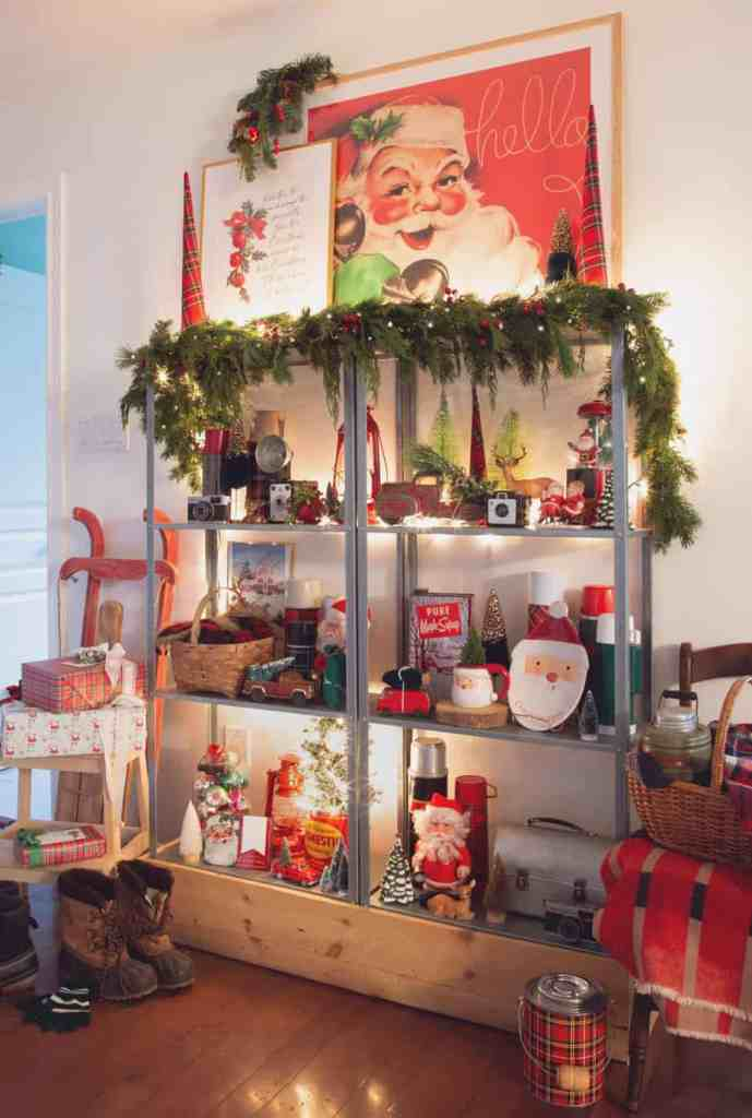Vintage santa print |How to Hang Garland by popular Canada DIY blog, Fynes Designs: image of garland hanging on a shelf decorated with various Christmas decor items.