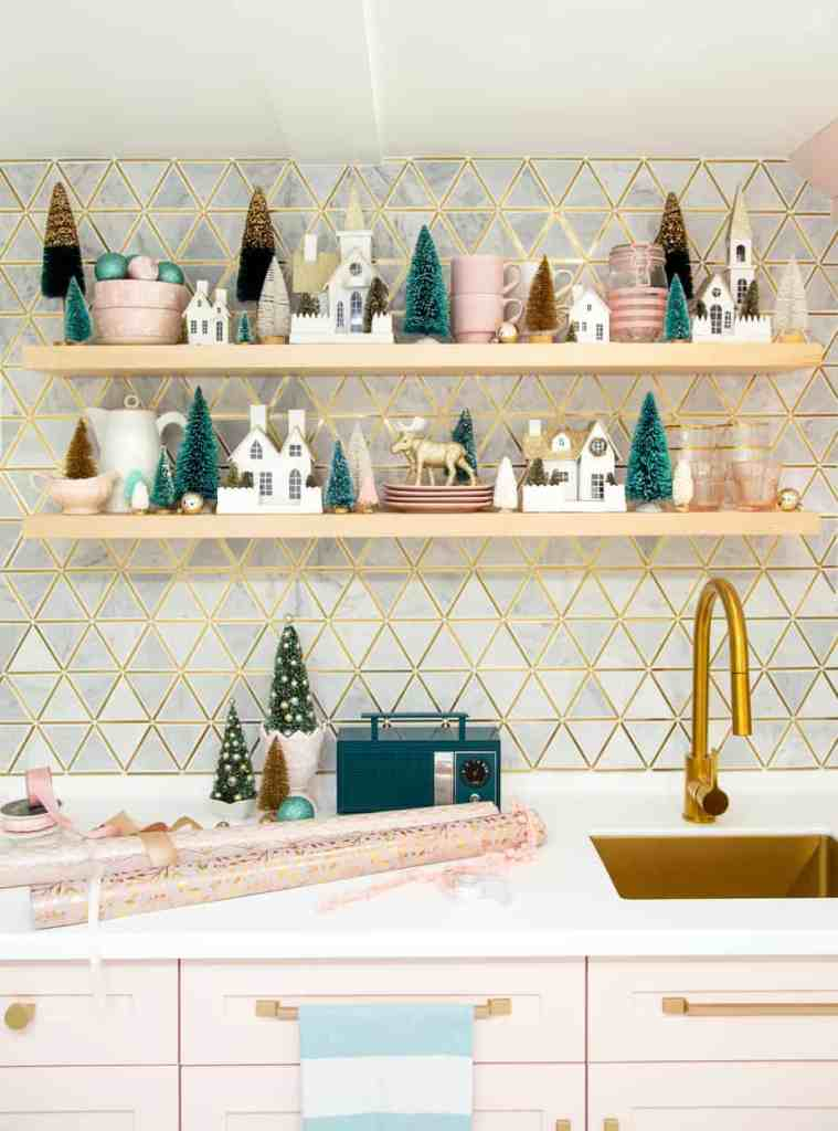 Pink and teal Christmas decorating ideas |Colorful Christmas Decorations by popular Canada Interior Design blog, Fynes Designs: image of floating kitchen shelves decorated with Christmas decor.