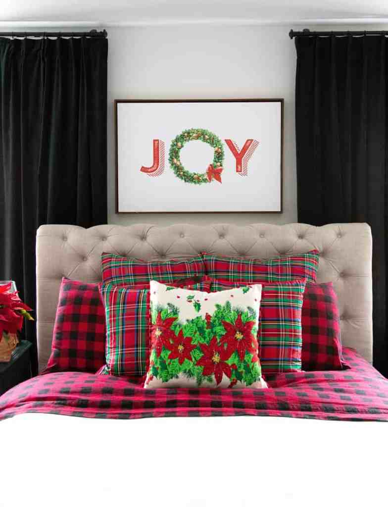 Plaid Christmas master bedroom decor |Colorful Christmas Decorations by popular Canada Interior Design blog, Fynes Designs: image of a bed with made with Christmas bedding.
