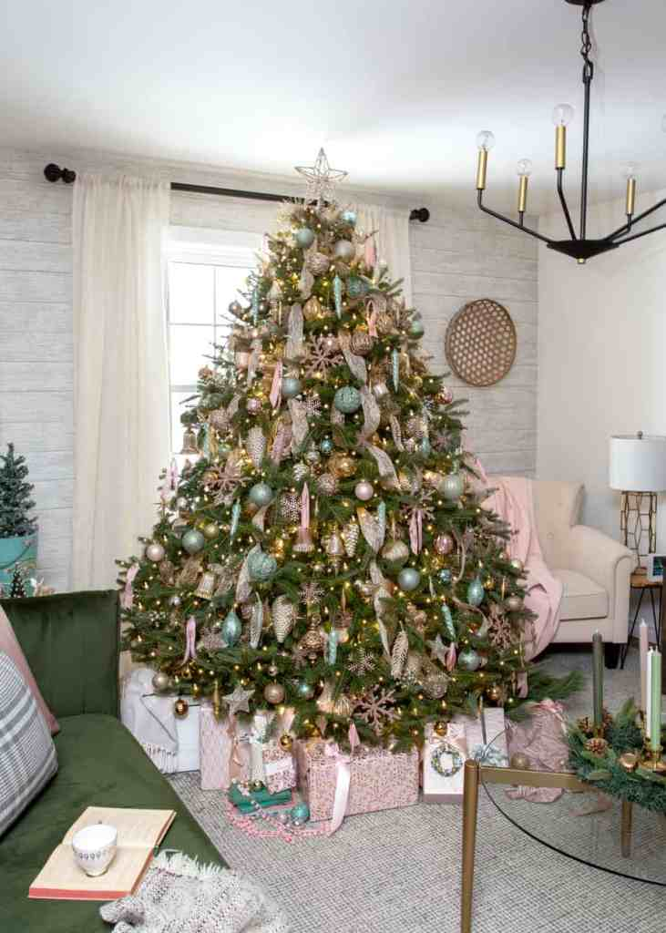 Pink and mint green real Christmas tree | Colorful Christmas Decorations by popular Canada Interior Design blog, Fynes Designs: image of a pink and mint green Christmas tree.