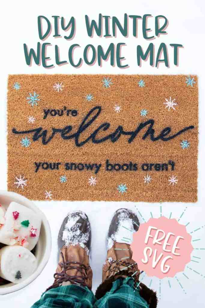 FREE SVG for a Winter Welcome Mat. Paint your own funny doormat |Winter Doormat by popular Canada DIY blog, Fynes Designs: Pinterest image of a woman holding a mug filled with hot chocolate and marshmallows and standing in front of a winter doormat.