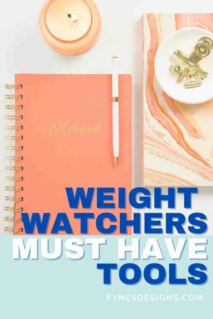 A list of Weight Watchers tools for beginners to the My WW smart points program. |Weight Watchers Tools by popular Canada lifestyle blog, Fynes Designs: Pinterest image of a coral colored notebook and white pen next to a white dish holding gold paper clips in it.