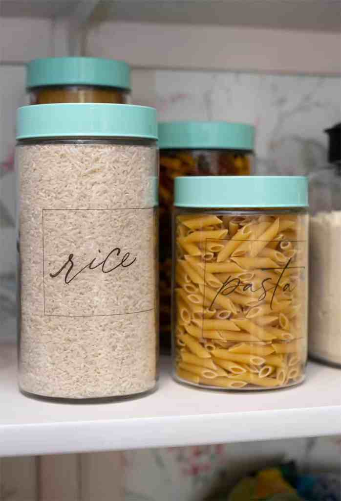 Pantry organization tips plus free kitchen pantry labels |Pantry Organization Tips by popular Canada interior design blog, Fynes Designs: image of clear containers with modern pantry labels.