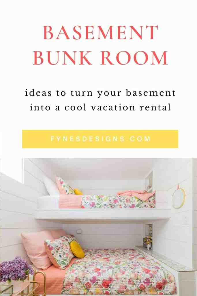 Basement Bunk Room Ideas for a cool Vacation Rental | Bunk Room Ideas by popular Canada home design blog, Fynes Designs: Pinterest image of a basement bunk room with white shiplap wall, mid century modern chandelier, bunk beds with floral bedding, white drapes, queen bed with a pink headboard and white and floral bedding, and a gold metal and glass top side table with a white basket filled with blankets resting underneath.