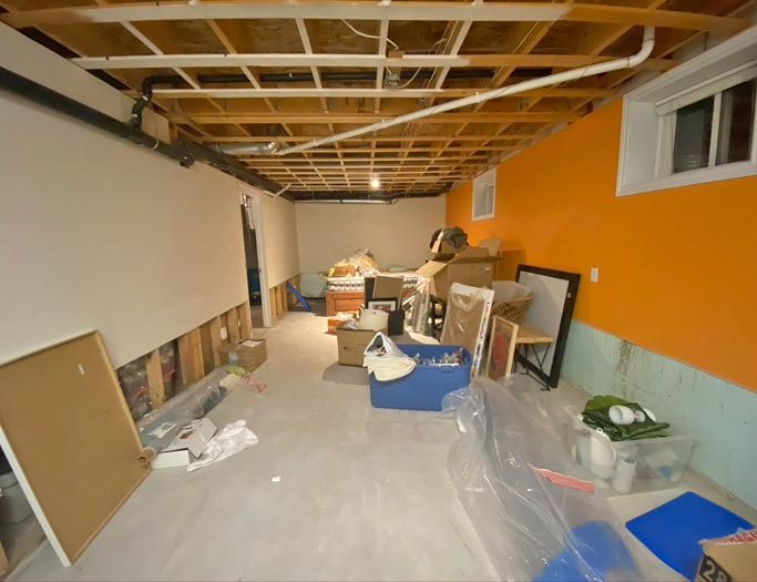 Bunk Room Ideas by popular Canada home design blog, Fynes Designs: image of an unfinished basement.
