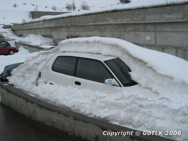 Car buried in heavy snow