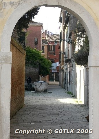 Old town scene through archway