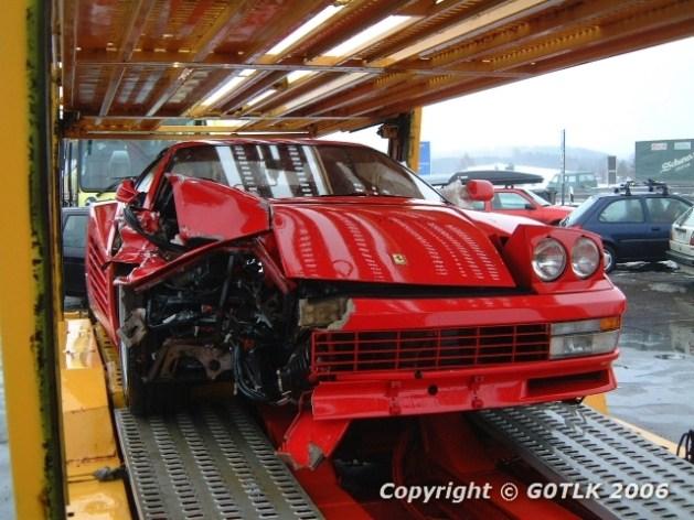 Crunched Ferrari on trailer