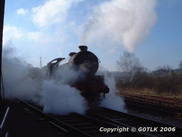 Live steam engine in part silhouette
