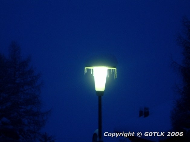 Icicles on lit streetlamp