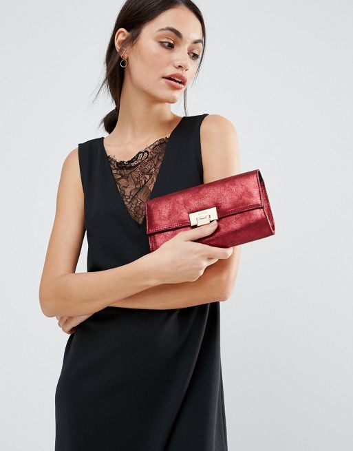 red clutch bag by dune
