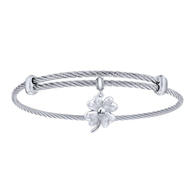 An adjustable silver and stainless-steel cable bracelet with a four-leaf clover dangle