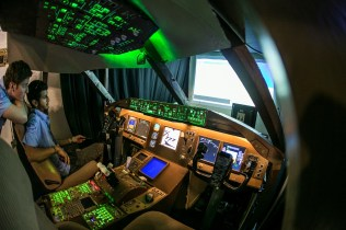 Boeing representatives demonstrating a 777 cockpit (photo: International Paris Air Show/Adrien Daste).