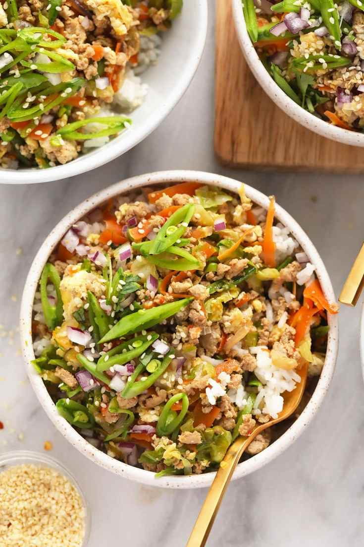 egg roll in a bowl served with rice