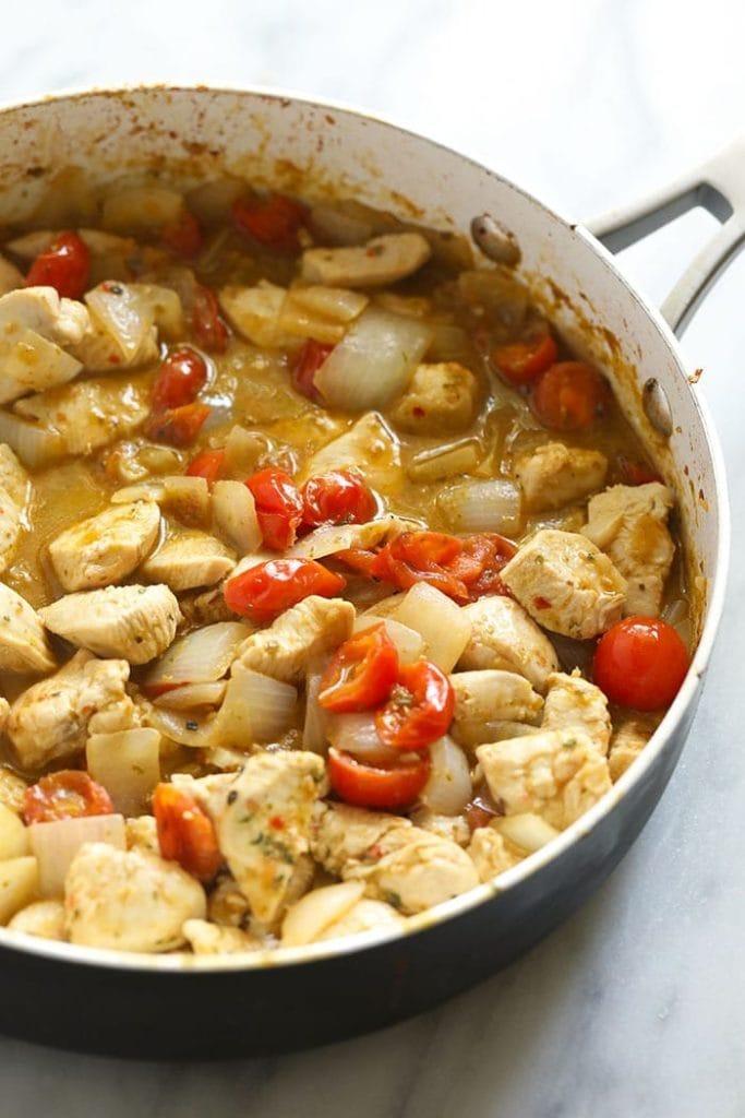 Pesto chicken pasta in a skillet pan.