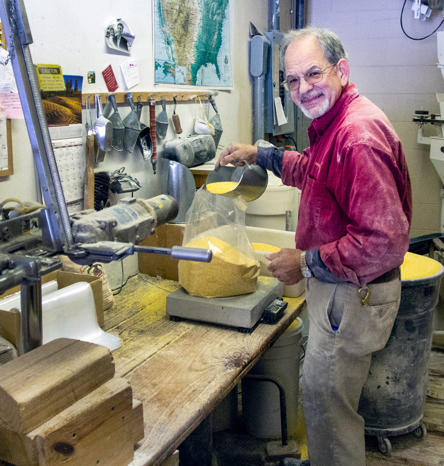 George Holland grinding cornmeal