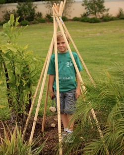 boy standing in teepee